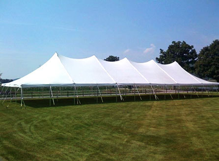40-foot by 120-foot pole tent with white canopy