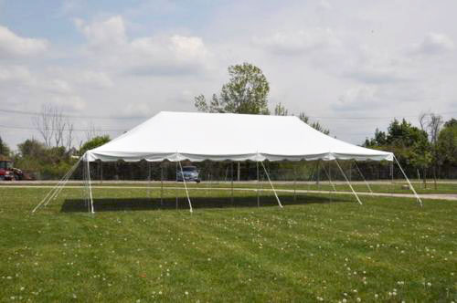 20 foot by 40 foot pole tent with white canopy