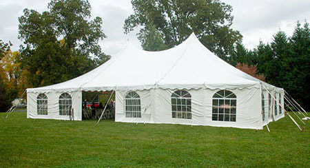 40-foot by 60-foot pole tent with white canopy and windowed sidewalls